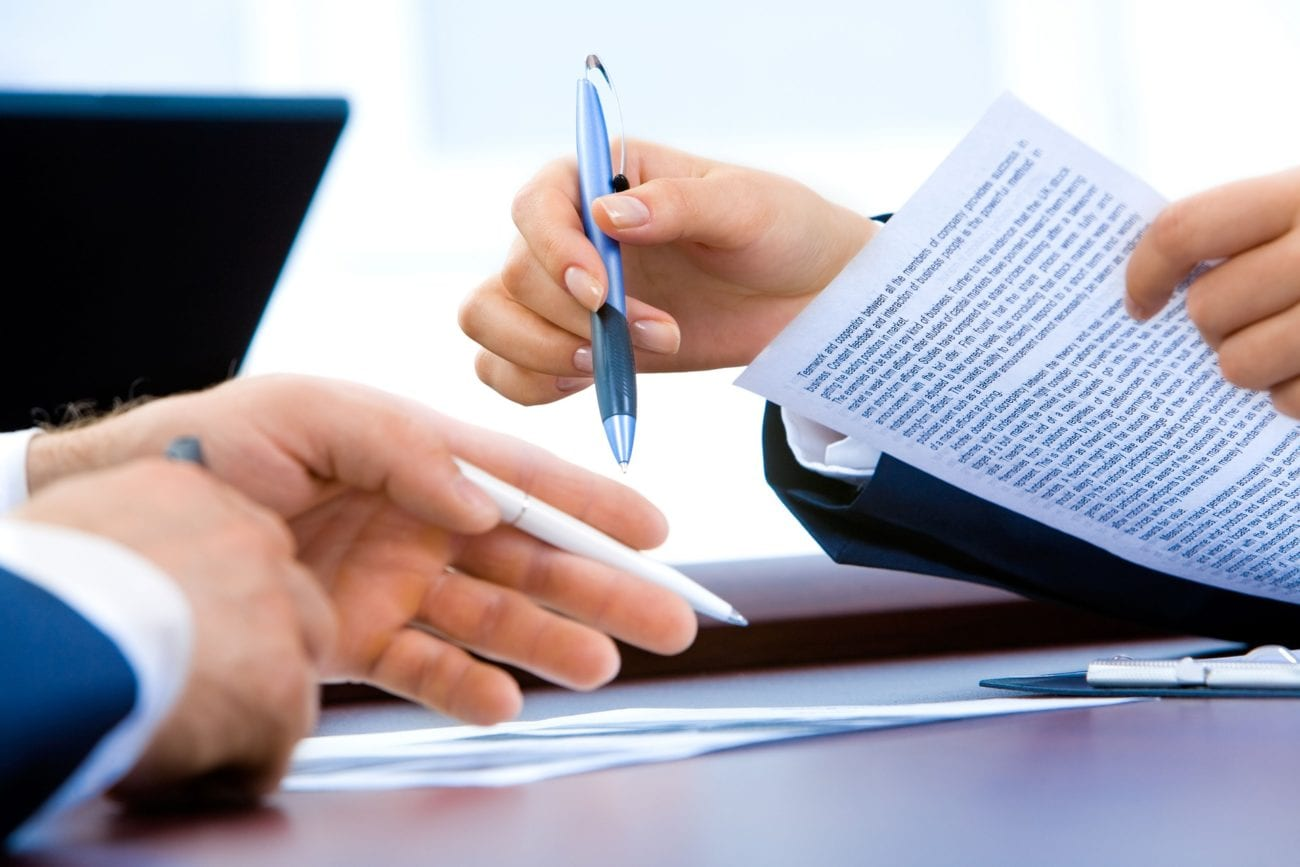 Businesspeople signing document